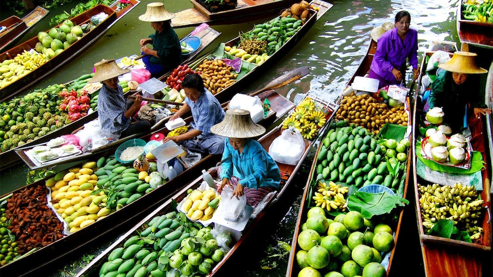 Show item 5 of 6. Beautiful view of the vendors at the Damnoen Saduak Floating Market in Bangkok, Thailand