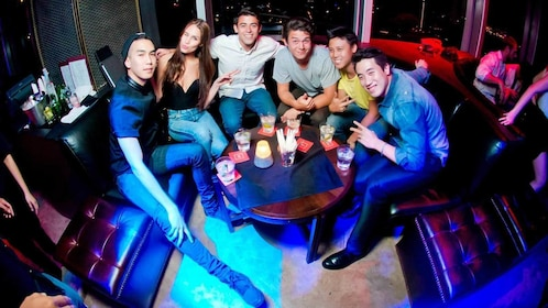 friends gathered at a table at the club in Bangkok