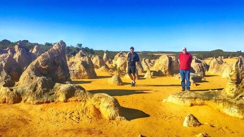 men walking through the rocky desert in Perth