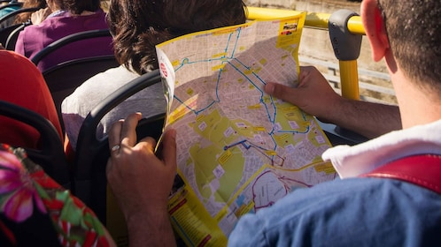 A man holding a city map of Athens