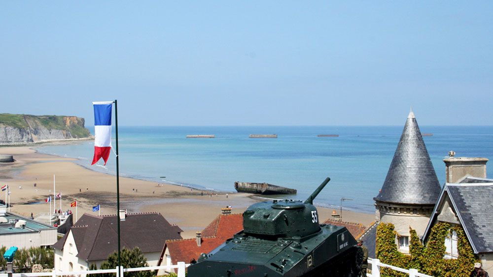 Military tank memorial overlooking beach in Normandy