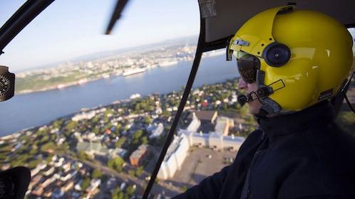Helicopter pilot flying over Quebec