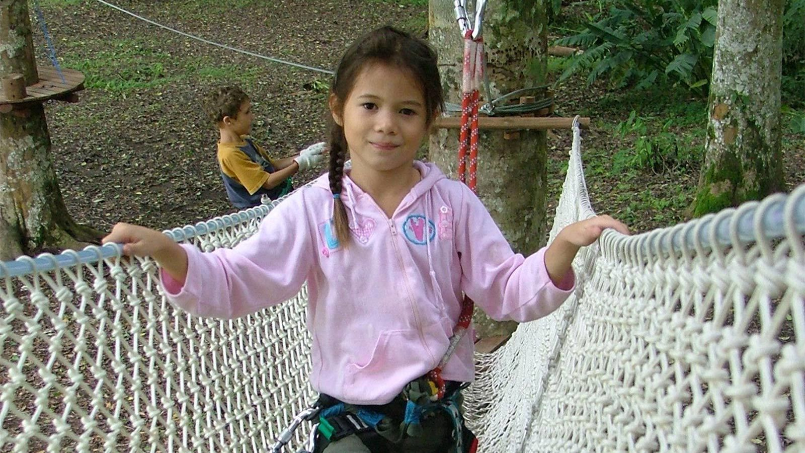 Child on a ropes course at the Bali Treetop Adventure Park