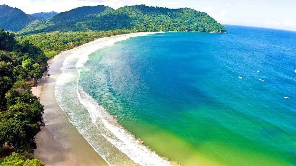 visiting a crescent shaped beach in Trinidad and Tobago
