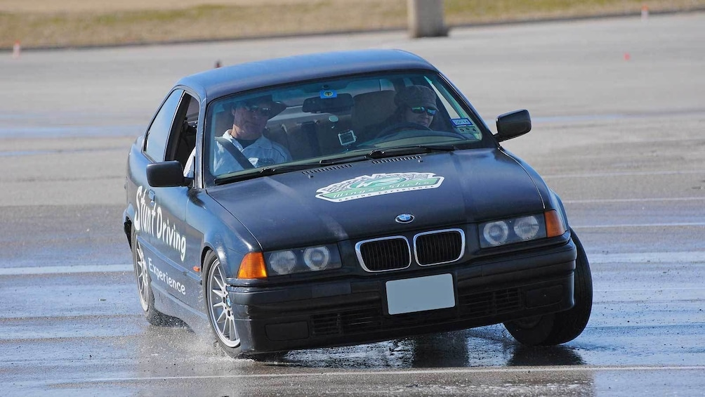Show item 4 of 5. stunt car drifting on the wet tracks in Ontario