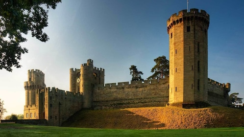 the sun setting on the Leeds Castle in the United Kingdom