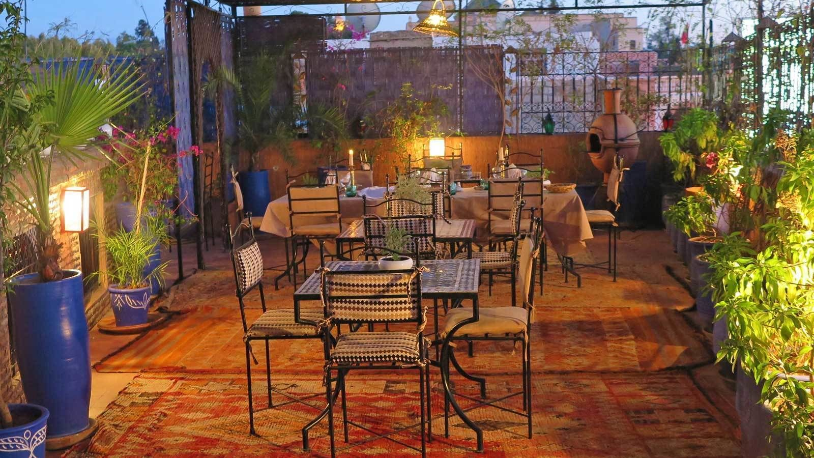 small dining area outside during the evening in Marrakech