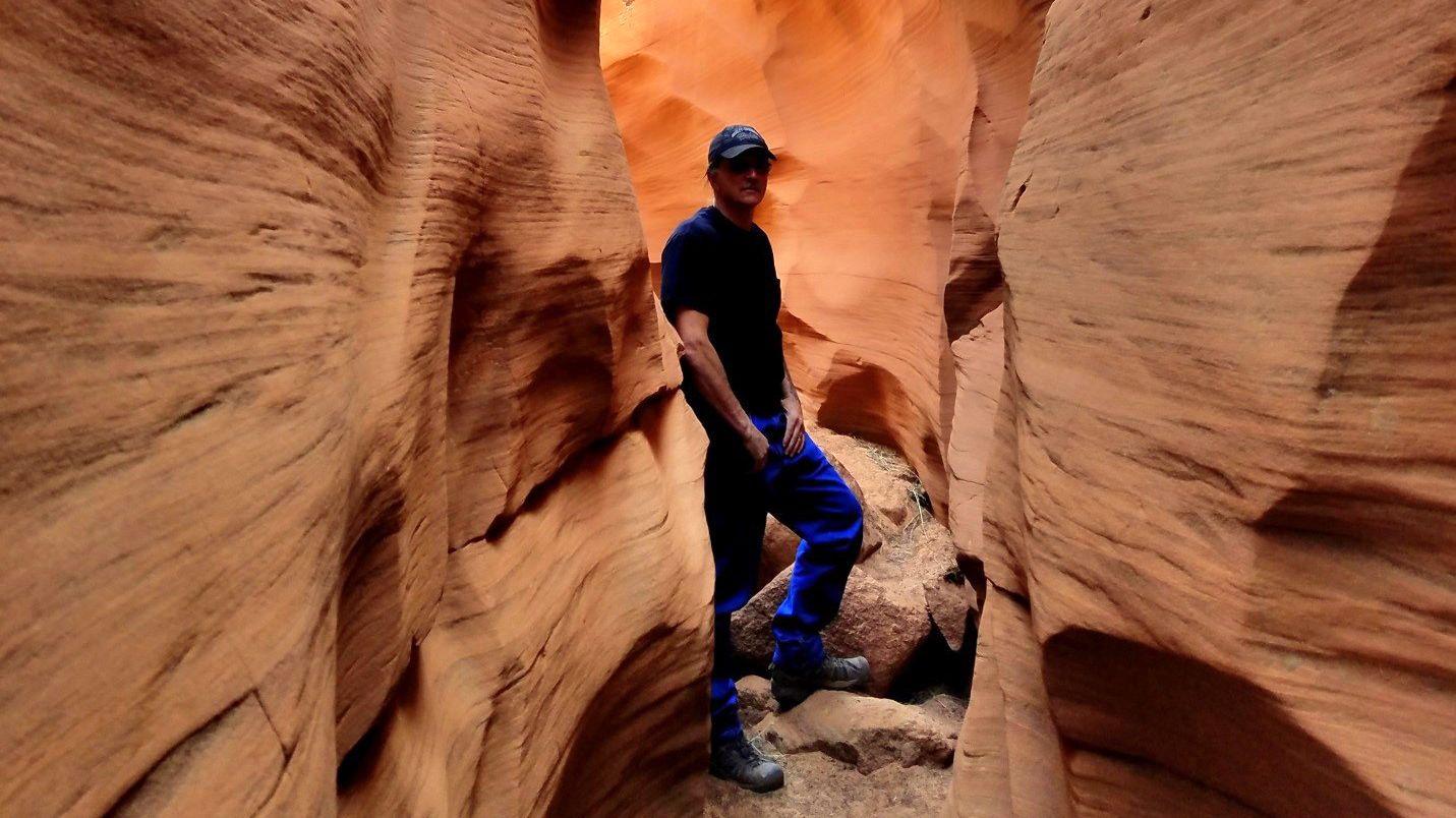 Man walks through Cathedral Slot Canyon