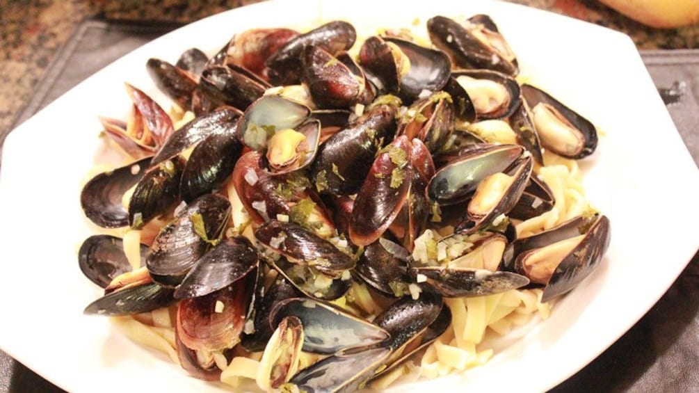 Show item 3 of 5. close up of mussels at cooking school
