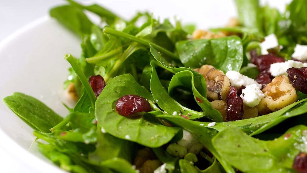 Show item 5 of 5. close up of spinach salad at cooking school