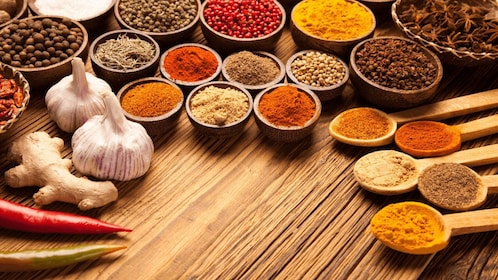 A table full of spices, beans and garlic.