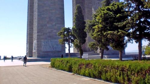 walking along a tall pillar monument in Turkey