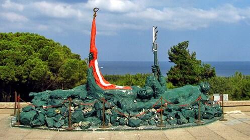 sculpture next to a flag in Turkey