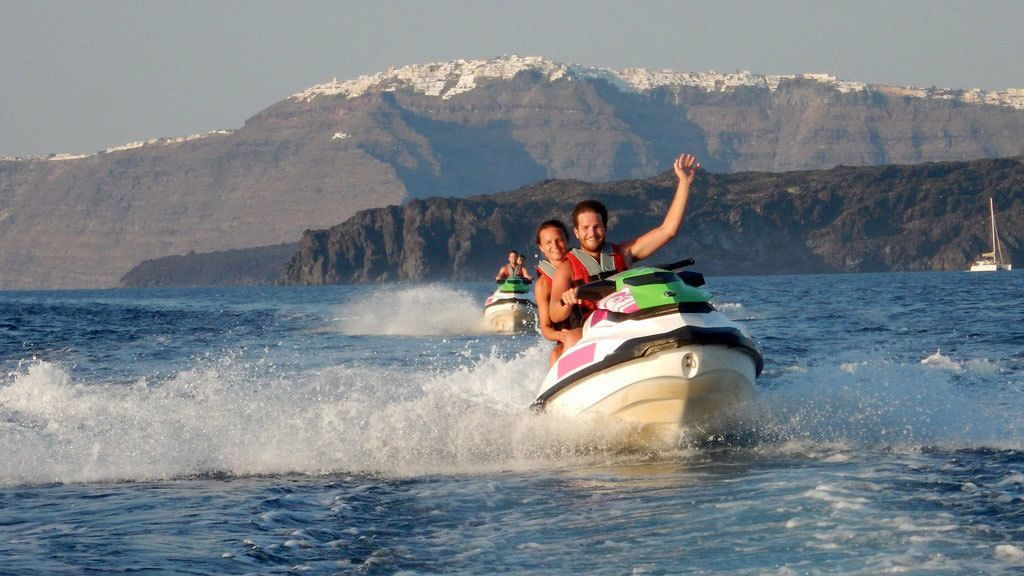 Jet skiing couple in Santorini