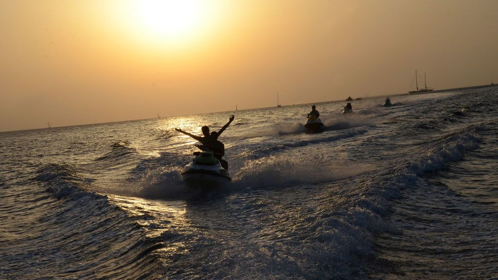Jet skiing group at sunset in Santorini