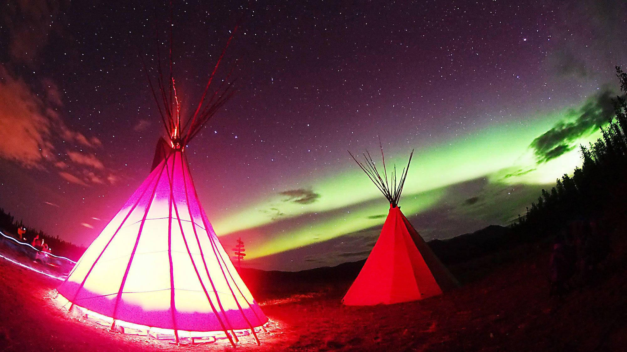 Teepees at the Yukon Night Sky Aurora Borealis Viewing in the Canada Territories