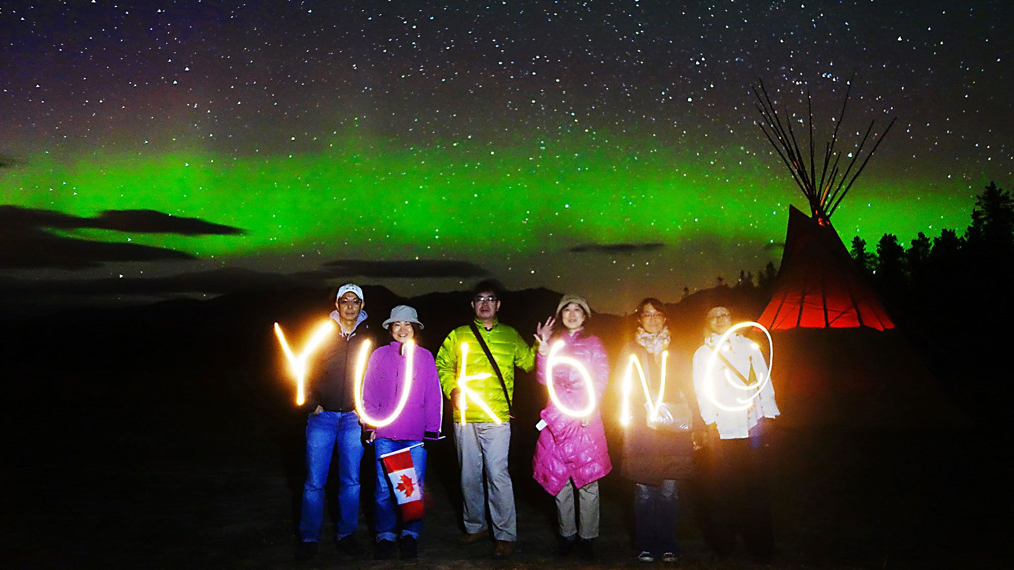 Group enjoying the aurora borealis in Canada
