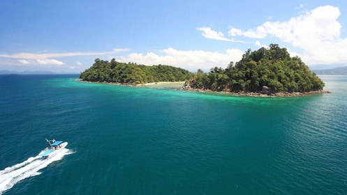 boat approaching island in malaysia