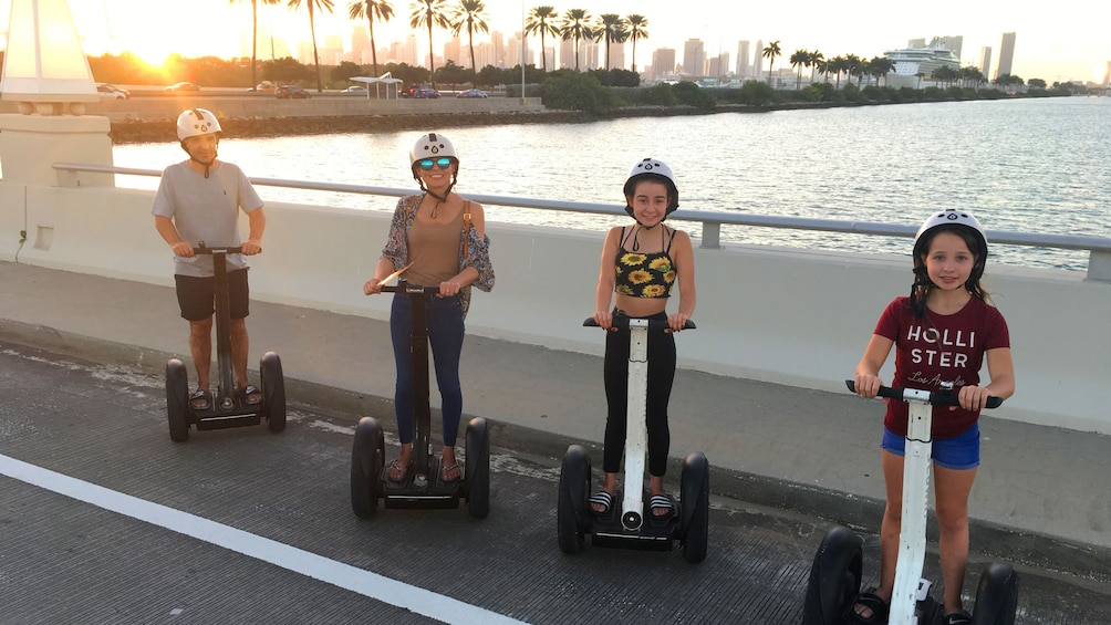 Apri foto 4 di 7. Segway tour group on a bridge at dusk in Miami