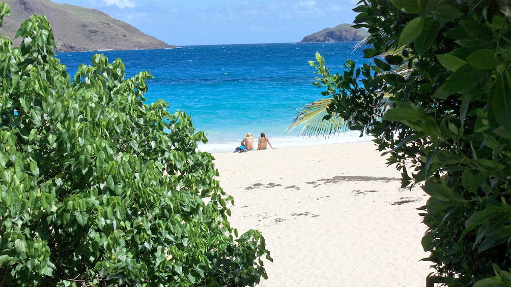 Show item 2 of 10. Guests on the beach in St. Martin