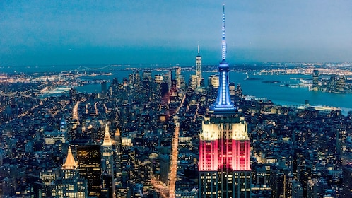 Aerial view of the Empire State Building and city at night in New York
