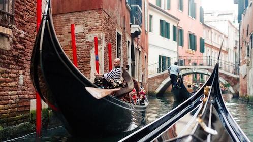 Multiple Gondolas in canal of Venice