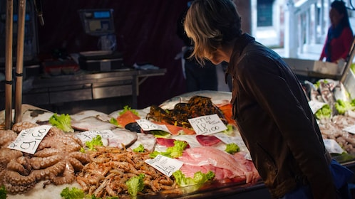 Woman looking at seafood on ice