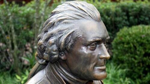 an old bronze sculpture of Thomas Jefferson in Charlottesville