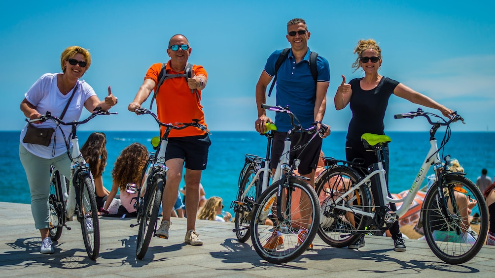 Apri foto 2 di 5. Four Bicyclists pose for picture in Spain