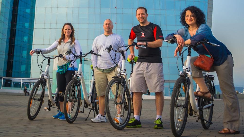 Apri foto 3 di 5. Four bicyclists pose for picture in Spain