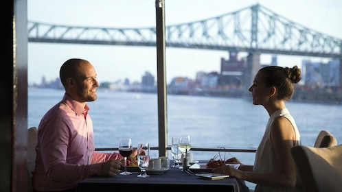 Couple eating dinner on a boat in Montreal