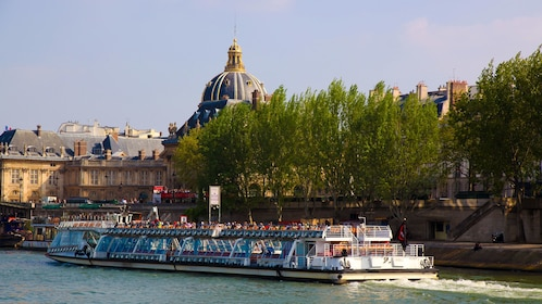Historical building behind the trees during Bateaux-Mouches Capital Sightseeing Cruise in Paris, France