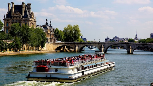 Bateaux-Mouches Capital Sightseeing Cruise boat traveling down canal in Paris, France