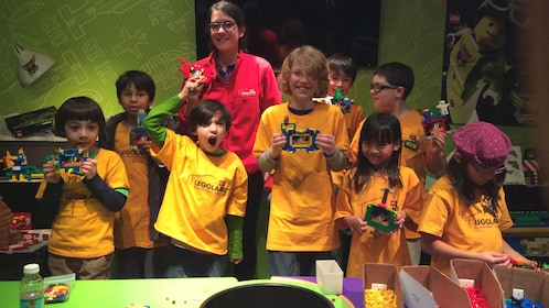 Several kids posing together with legos.