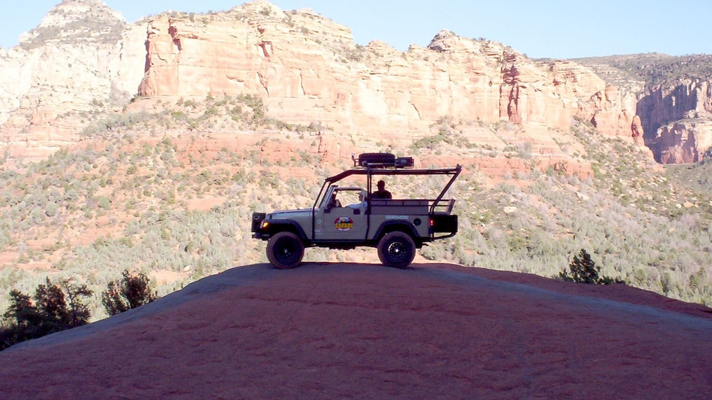 Show item 3 of 4. Jeep in the shade of Mogollon Rim