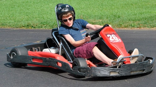 man on red go kart