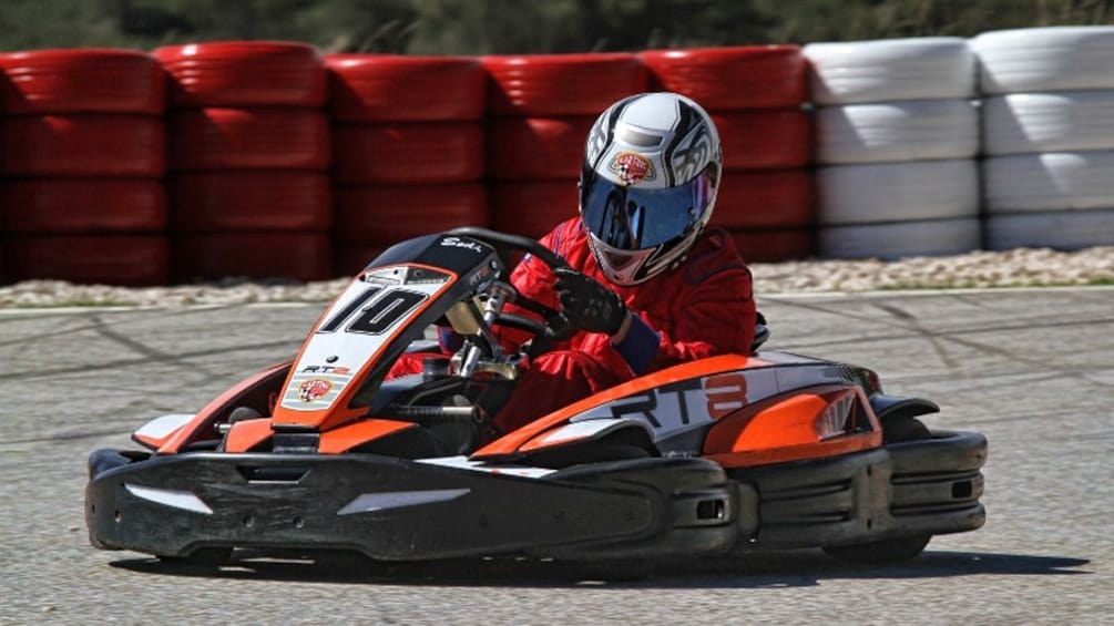 Show item 8 of 8. person in full racing helmet on go kart