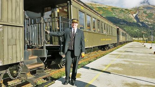 train operator welcoming people