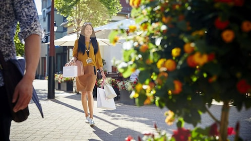 Woman with bags in a shopping center in Frankfurt