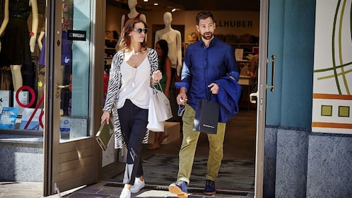 Couple emerging from a shop in Frankfurt