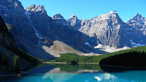 lake scenery with snow capped mountains in Canada