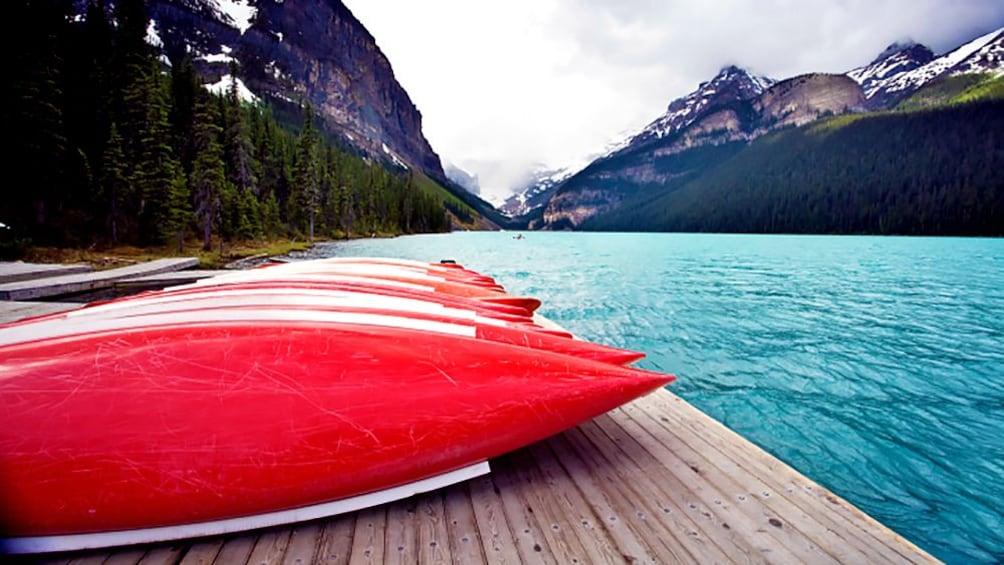 Show item 1 of 5. kayaks along Lake Louise in Canada