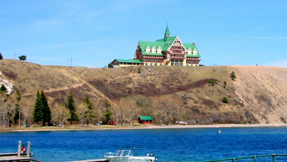 Show item 5 of 5. veiw of the lodging establishment on top of a hill in Canada