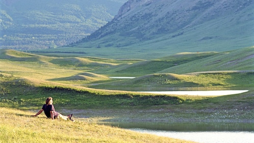 man relaxing by the hillsides in Canada