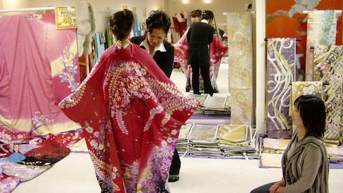 Woman being fitted for a kimono
