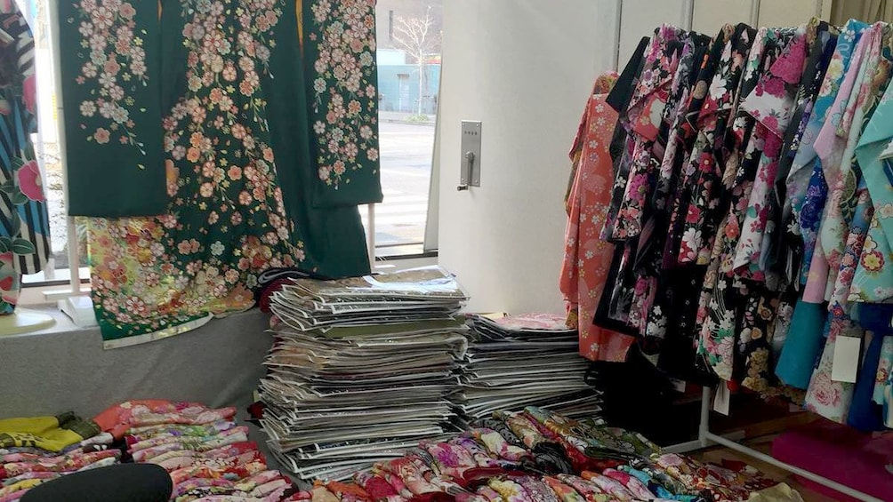 Show item 3 of 5. Colorful kimonos in a shop in Nagoya