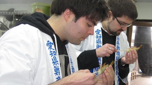 Men preparing sushi in a class in Nagoya