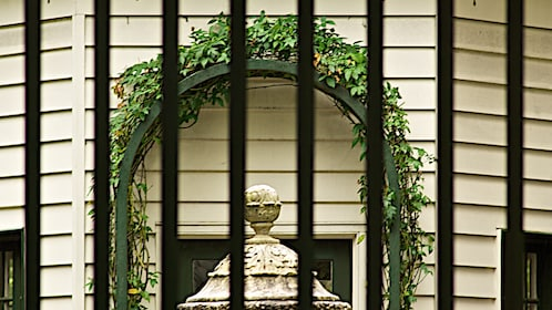 Close up of gate at historic house.