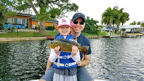 father and daughter fishing in Boca Raton