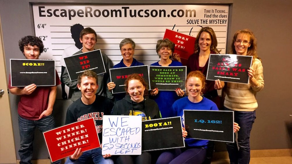 Show item 3 of 5. group accomplishing the escape room activity in Tucson
